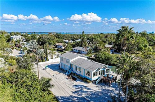 Photo of 580 JUNGLE QUEEN WAY, LONGBOAT KEY, FL 34228 (MLS # A4448764)