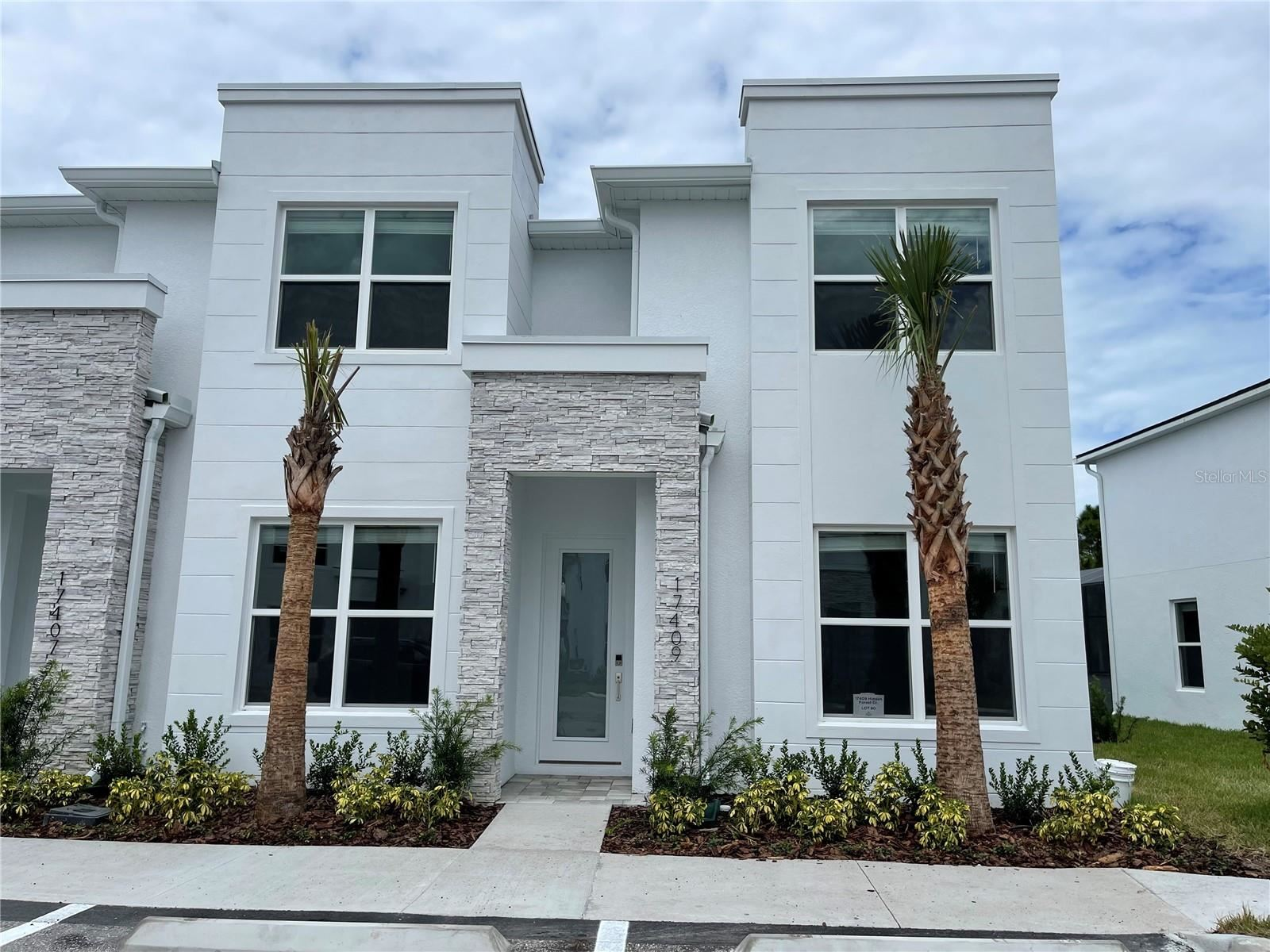 Photo of 17409 HIDDEN FOREST DRIVE, CLERMONT, FL 34714 (MLS # S5056766)
