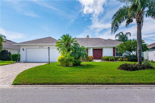 Photo of 8704 53RD AVENUE W, BRADENTON, FL 34210 (MLS # A4512772)