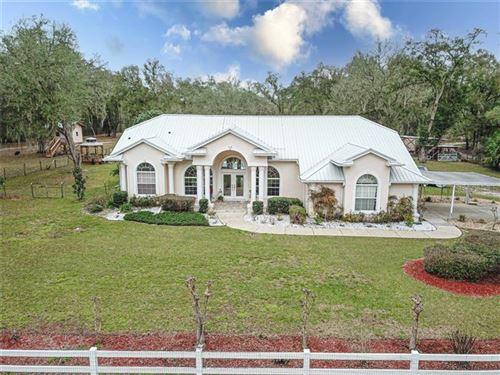 Photo of 11831 SW HIGHWAY 484, DUNNELLON, FL 34432 (MLS # OM615772)