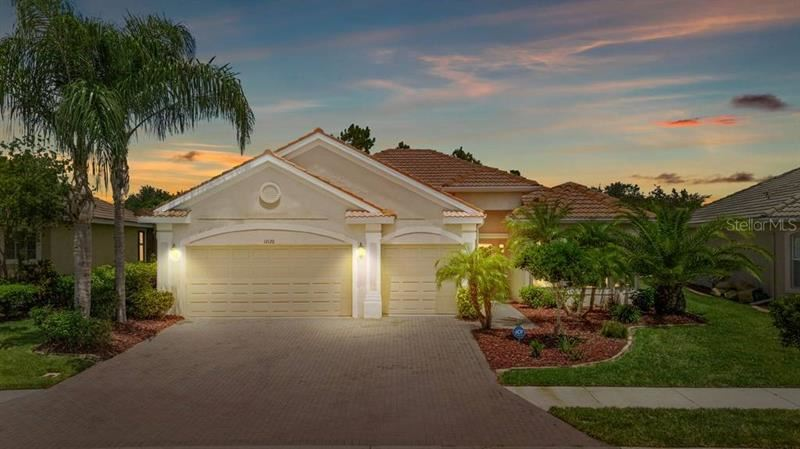 Photo of 12120 GRANITE WOODS LOOP, VENICE, FL 34292 (MLS # A4473775)