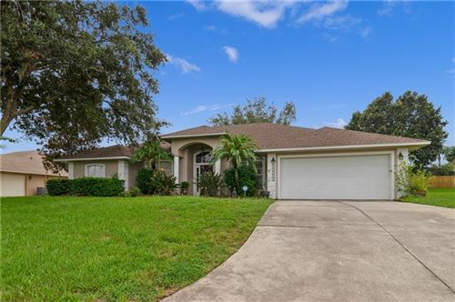 Photo of 10902 VERSAILLES BOULEVARD, CLERMONT, FL 34711 (MLS # O5892776)