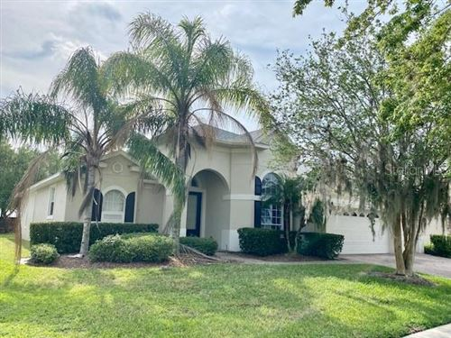 Photo of 8857 WARWICK SHORE CROSSING, ORLANDO, FL 32829 (MLS # O5939777)
