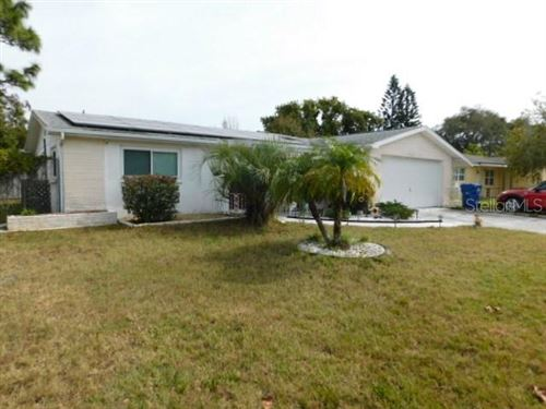 Photo of 1428 MAYBURY DRIVE, HOLIDAY, FL 34691 (MLS # U8071777)
