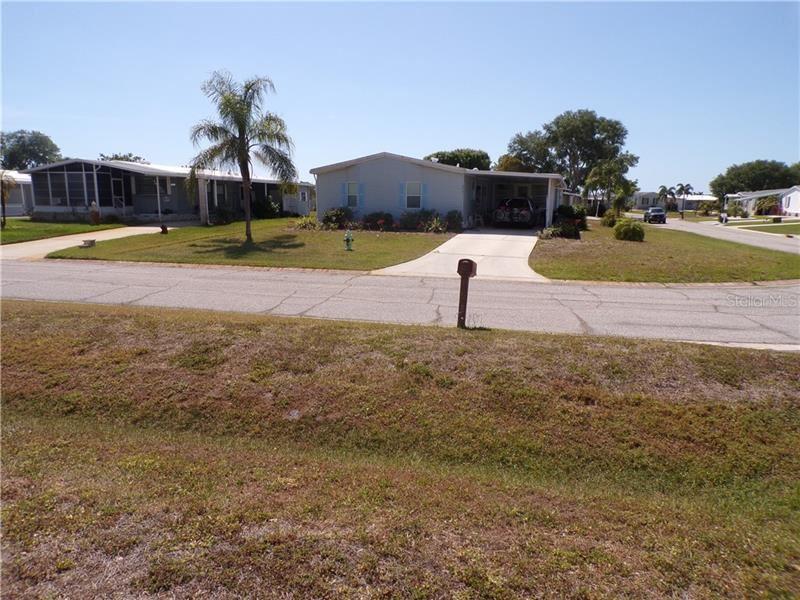 Photo of 6065 TOUCAN DRIVE, ENGLEWOOD, FL 34224 (MLS # D6117777)