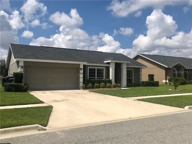 Photo of 1040 CONDOR DRIVE, HAINES CITY, FL 33844 (MLS # O5868785)
