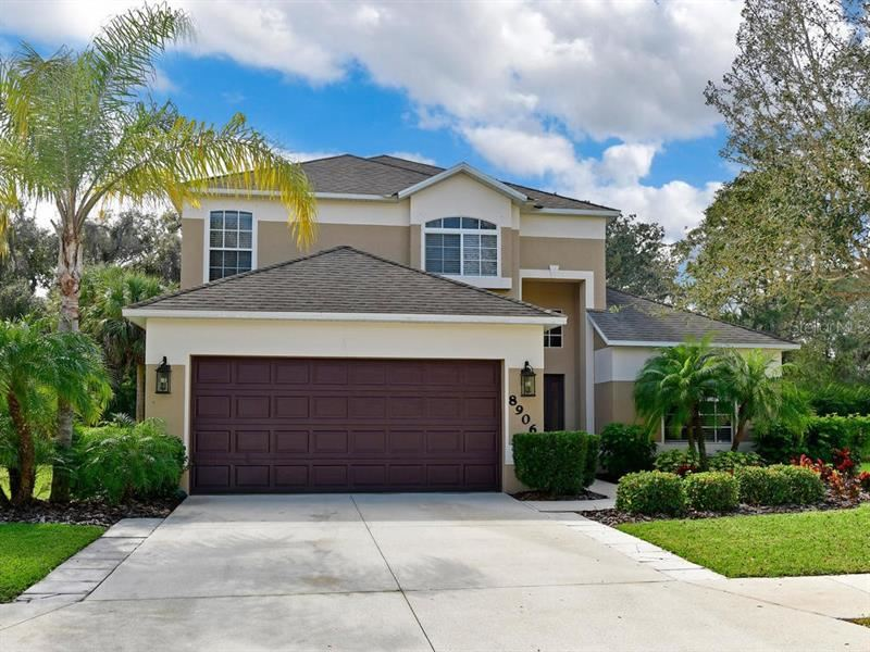 Photo of 8906 FOUNDERS CIRCLE, PALMETTO, FL 34221 (MLS # A4463789)