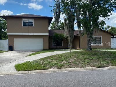Photo of 1130 QUINTUPLET DRIVE, CASSELBERRY, FL 32707 (MLS # O5957791)
