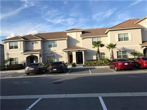 Photo of 1593 MOON VALLEY DR, CHAMPIONS GATE, FL 33896 (MLS # O5749795)