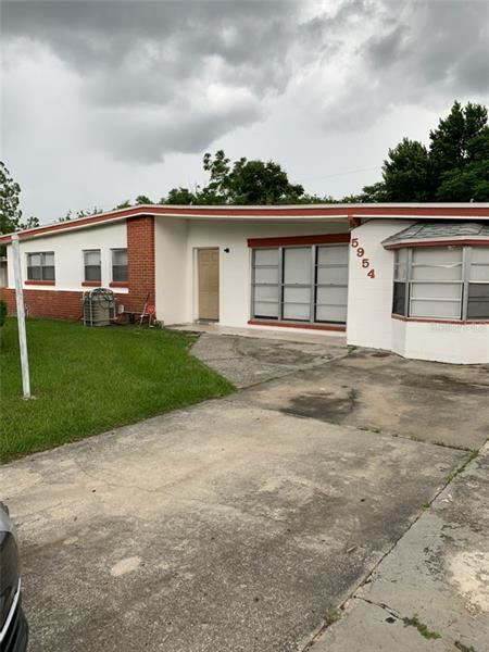 5954 FOREST GROVE BOULEVARD, Orlando, FL 32808 - #: O5885796