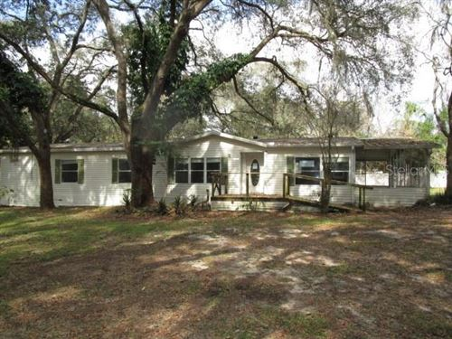 Photo of 10810 TUCKAWAY DRIVE, THONOTOSASSA, FL 33592 (MLS # T3290800)