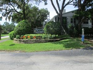 Photo of 3607 WHISPERING OAKS LANE #406, PALM HARBOR, FL 34684 (MLS # U8055804)