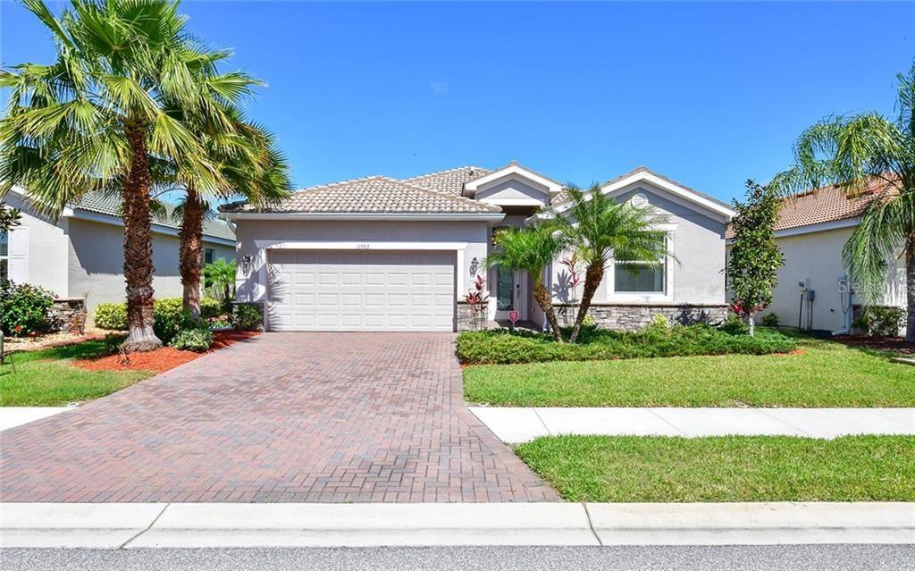 Photo of 11702 ANHINGA AVENUE, VENICE, FL 34292 (MLS # A4461804)