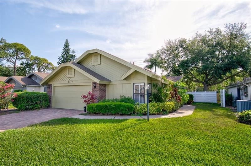 Photo of 7771 PINE TRACE DRIVE, SARASOTA, FL 34243 (MLS # A4497811)