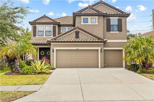 Photo of 5584 FOXTAIL PALM LANE, SARASOTA, FL 34233 (MLS # C7430833)