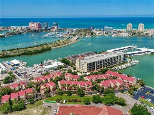 Photo of 240 WINDWARD PASSAGE #103, CLEARWATER BEACH, FL 33767 (MLS # U8088834)