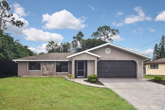 Photo of 23147 QUASAR BOULEVARD, PORT CHARLOTTE, FL 33952 (MLS # R4903835)