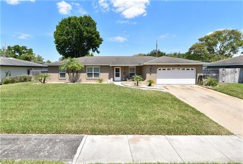 Photo of 4837 TELLSON PLACE, ORLANDO, FL 32812 (MLS # O5934836)