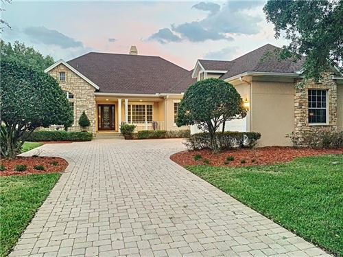 Photo of 8436 LAKE BURDEN CIR, WINDERMERE, FL 34786 (MLS # O5853844)