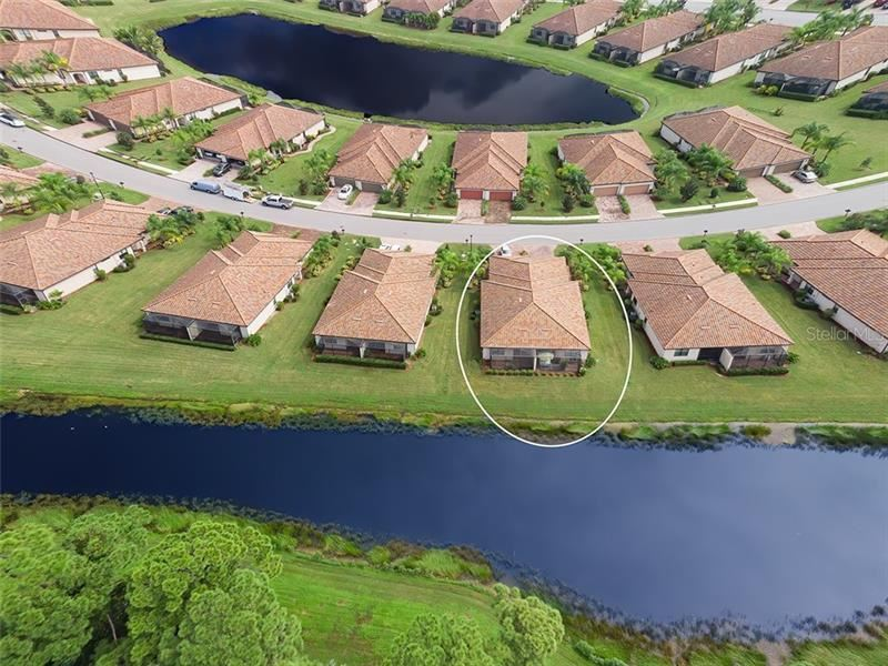 Photo of 6720 WILLOWSHIRE WAY, BRADENTON, FL 34212 (MLS # A4477845)