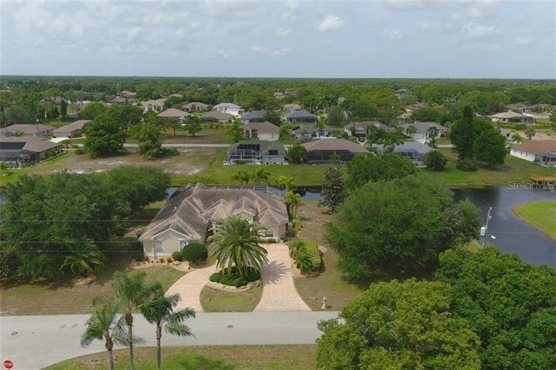 Photo of 59 MEDALIST ROAD, ROTONDA WEST, FL 33947 (MLS # D6117848)