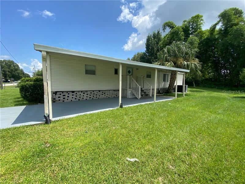 Photo of 1099 PINEAPPLE WAY, KISSIMMEE, FL 34741 (MLS # S5037850)