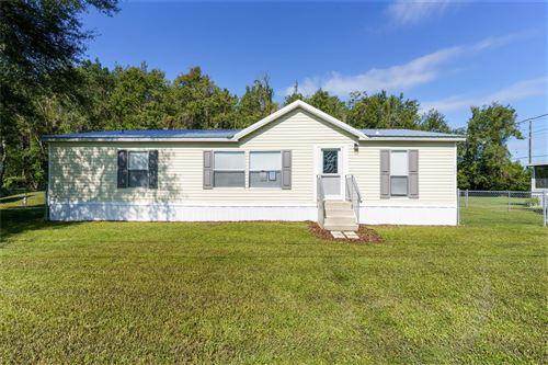 Photo of 2131 ODESSA GARDENS LANE, ODESSA, FL 33556 (MLS # T3331852)
