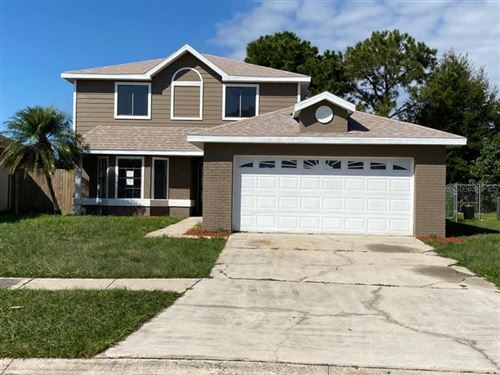 Photo of 124 PINEWOOD CIRCLE, KISSIMMEE, FL 34743 (MLS # O5902853)