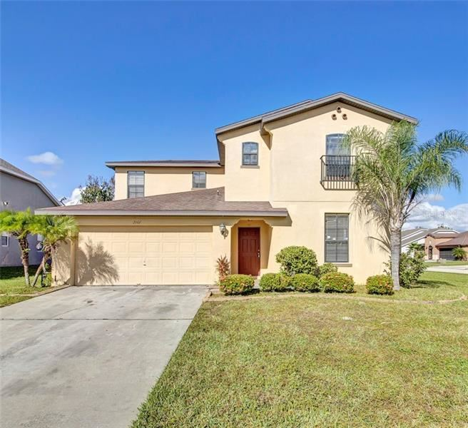 Photo of 2101 QUEENSTOWN DRIVE, KISSIMMEE, FL 34746 (MLS # O5907854)