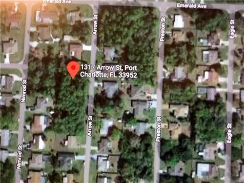 Photo of 1317 ARROW STREET, PORT CHARLOTTE, FL 33952 (MLS # C7437858)