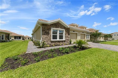 Photo of 1179 TRAPPERS TRAIL LOOP, CHAMPIONS GT, FL 33896 (MLS # T3237858)