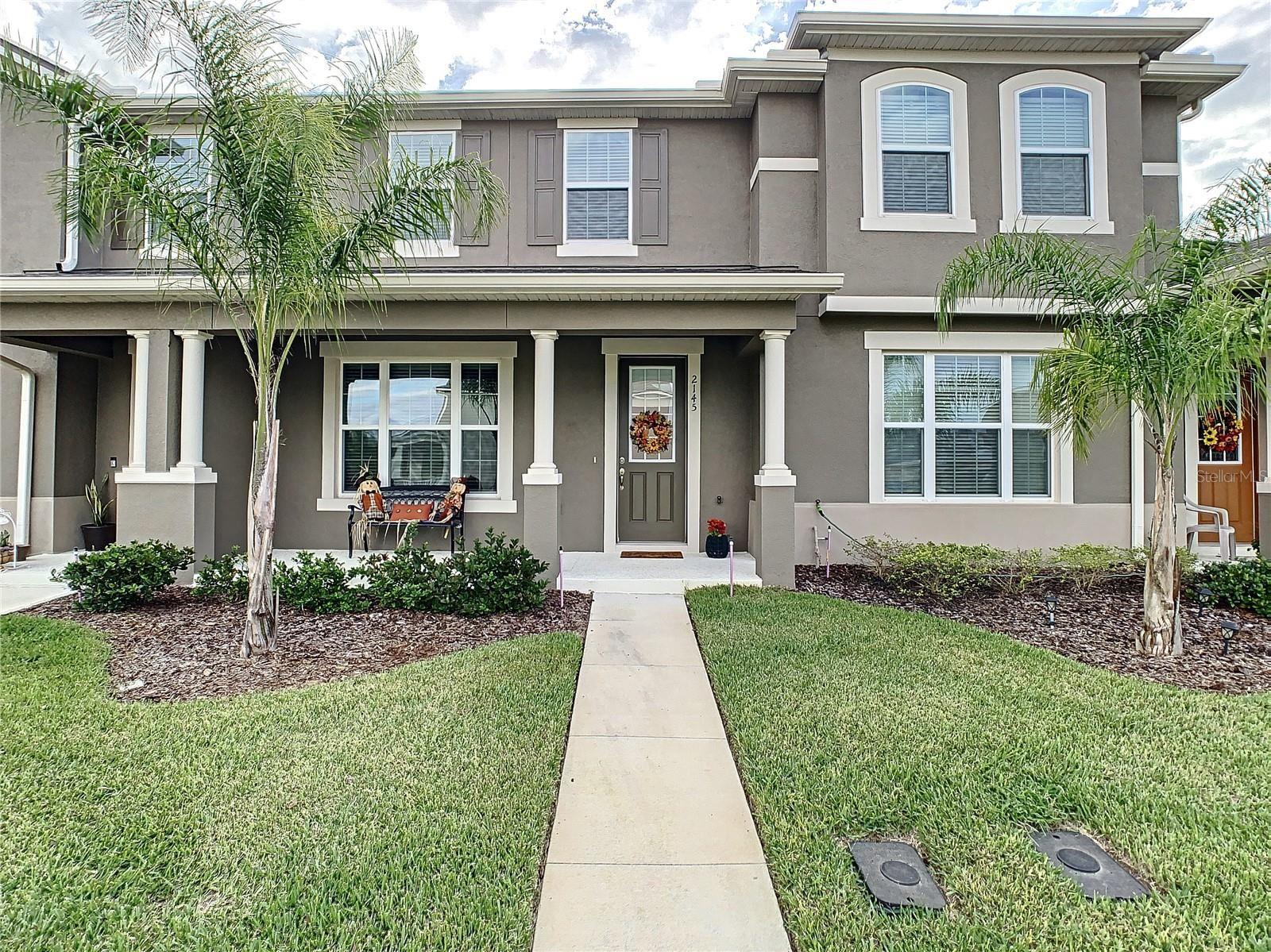Photo of 2145 VALENCIA BLOSSOM ST., CLERMONT, FL 34711 (MLS # S5056862)