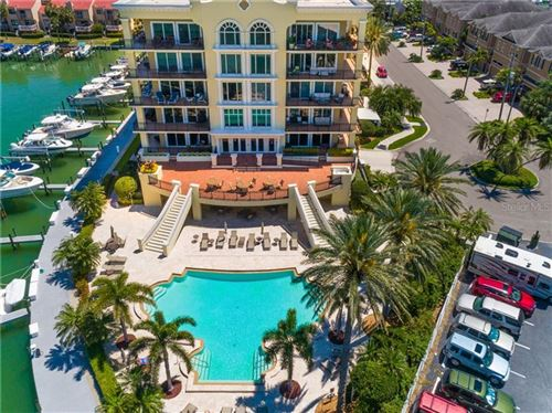 Photo of 202 WINDWARD PASSAGE #301, CLEARWATER BEACH, FL 33767 (MLS # U8027866)