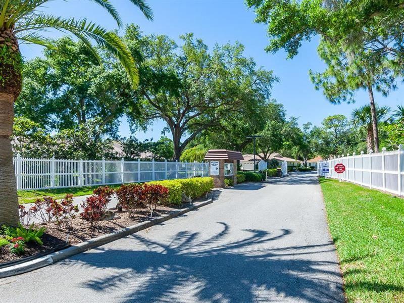 Photo of 5711 GARDEN LAKES MAJESTIC, BRADENTON, FL 34203 (MLS # A4469872)