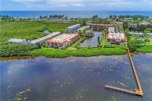 Photo of 3705 E BAY DRIVE #101, HOLMES BEACH, FL 34217 (MLS # A4476873)