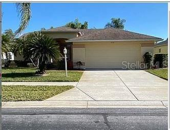 Photo of 1135 ASHBOURNE CIRCLE, TRINITY, FL 34655 (MLS # J925876)