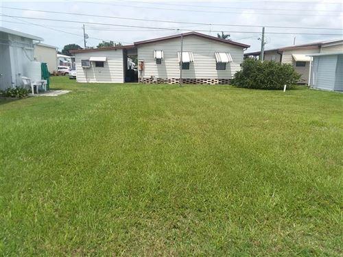 Photo of 1103 49TH AVENUE TERRACE W, BRADENTON, FL 34207 (MLS # O5918884)
