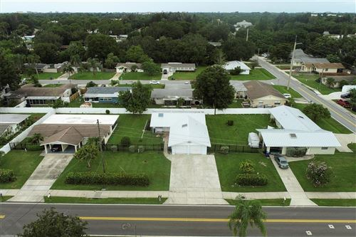 Photo of 5306-5312 S LOCKWOOD RIDGE ROAD, SARASOTA, FL 34231 (MLS # A4507885)