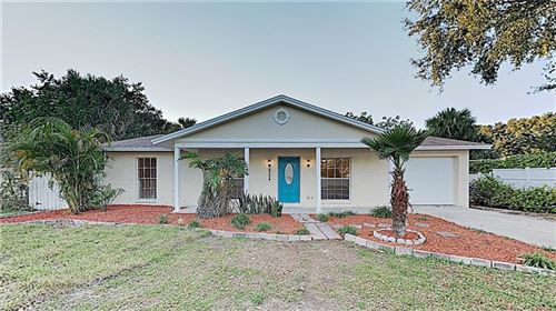 Photo of 8304 RIVERWOOD BOULEVARD, TAMPA, FL 33615 (MLS # O5827885)
