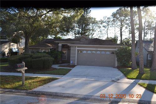 Photo of 14652 VILLAGE GLEN CIRCLE, TAMPA, FL 33618 (MLS # T3278885)