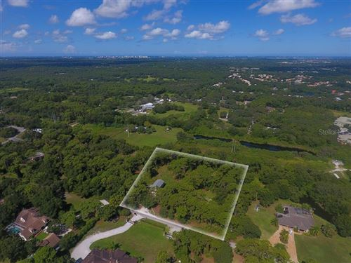 Photo of 5784 CENTER RING ROAD, SARASOTA, FL 34243 (MLS # A4472886)