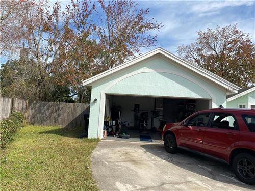 Photo of 7407 MARSEILLE CIRCLE, ORLANDO, FL 32822 (MLS # O5918886)