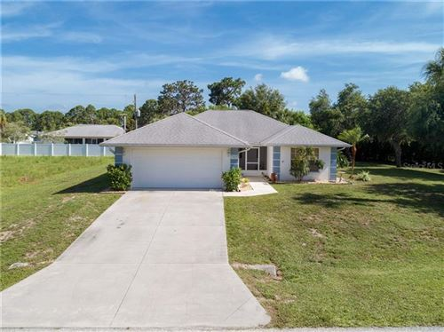 Photo of 11905 LEON AVENUE, PORT CHARLOTTE, FL 33981 (MLS # D6112887)