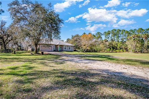 Photo of 920 LAKE HARNEY WOODS BOULEVARD, MIMS, FL 32754 (MLS # O5925888)