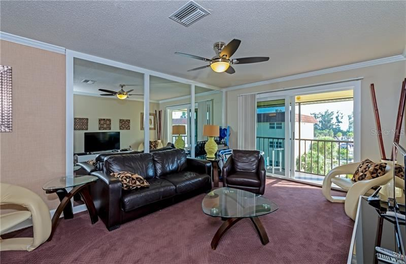 Photo of 915 BEACH ROAD #418, SARASOTA, FL 34242 (MLS # A4481890)
