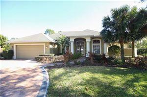 Photo of 8784 WITTENWOOD CV, ORLANDO, FL 32836 (MLS # O5557891)
