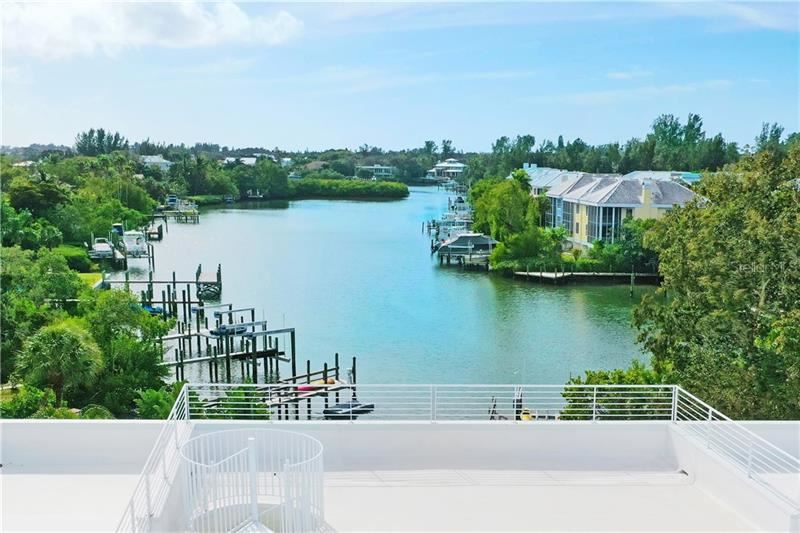 Photo of 3936 ROBERTS POINT ROAD, SARASOTA, FL 34242 (MLS # A4456892)