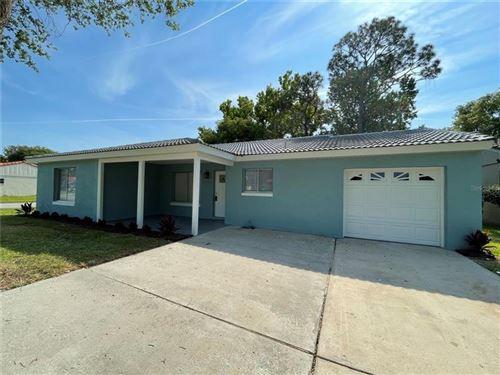 Photo of 10706 WINDSOR PLACE, ORLANDO, FL 32821 (MLS # S5049894)