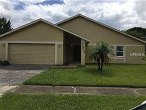 Photo of 12676 ILLINOIS WOODS LN, ORLANDO, FL 32824 (MLS # O5562895)