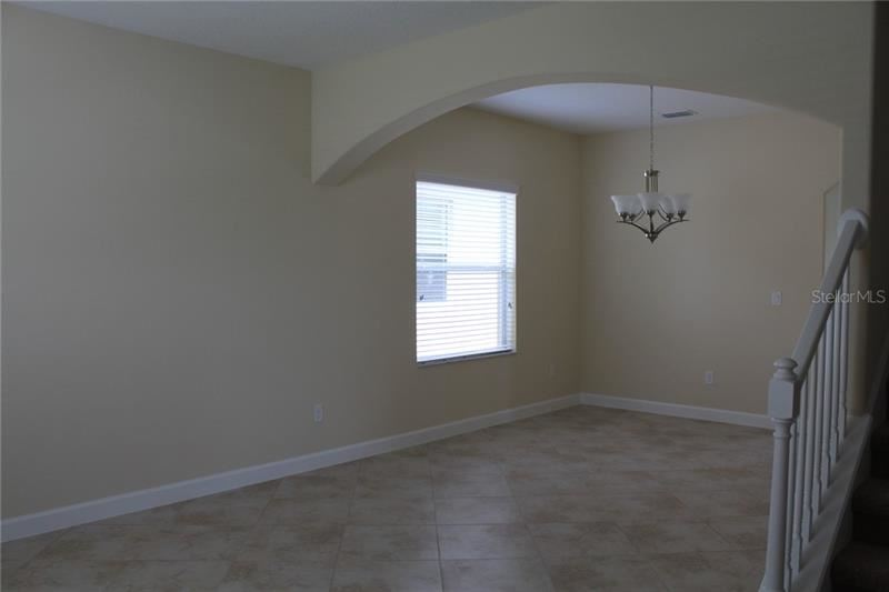 Photo of 1748 THETFORD CIRCLE, ORLANDO, FL 32824 (MLS # O5909895)